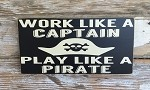 Work Like A Captain.  Play Like A Pirate.  Wood Sign