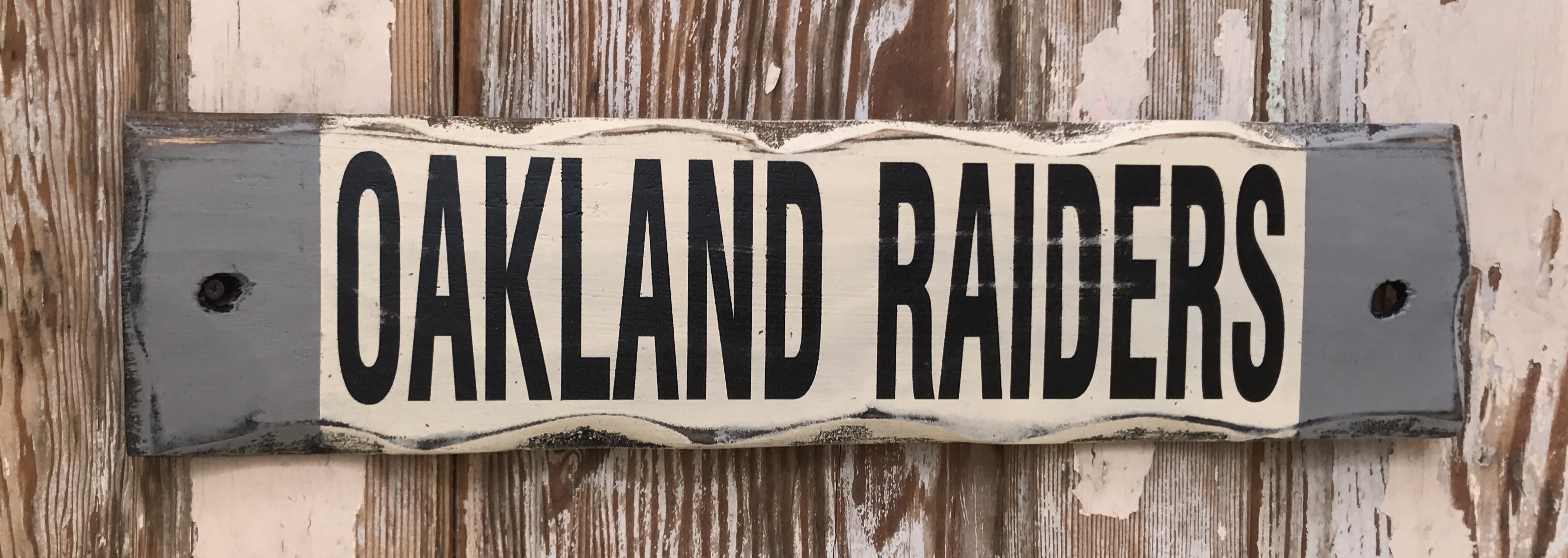 Oakland Raiders.  Rustic Wood Sign