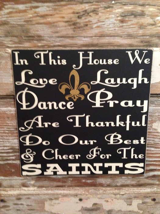 In This House We Love, Laugh, Dance, Pray, Are Thankful, Do Our Best & Cheer For The Saints.    Wood Sign