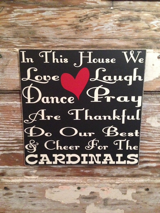 In This House We Love, Laugh, Dance, Pray, Are Thankful, Do Our Best & Cheer For The Cardinals.   Wood Sign