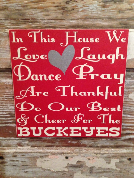In This House We Love, Laugh, Dance, Pray, Are Thankful, Do Our Best & Cheer For The Buckeyes.   Wood Sign