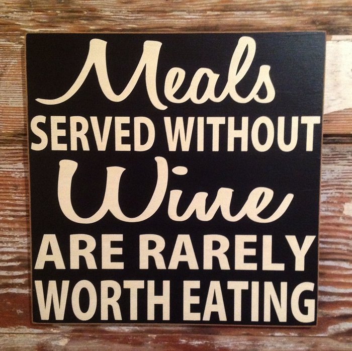 Meals Served Without Wine Are Rarely Worth Eating.  Wood Sign