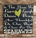 In This House We Love, Laugh, Dance, Pray, Are Thankful, Do Our Best & Cheer For The Seahawks.    Wood Sign