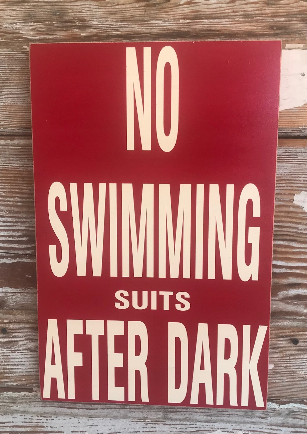 No Swimming Suits After Dark.  Wood Sign