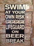 Swim At Your Own Risk.  Lifeguard On Beer Break.  Wood Sign
