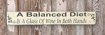 A Balanced Diet Is A Glass Of Wine In Both Hands.  Wood Sign