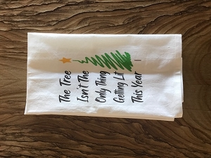 The Tree Isn't The Only Thing Getting Lit This Year.  Flour Sack Tea Towel