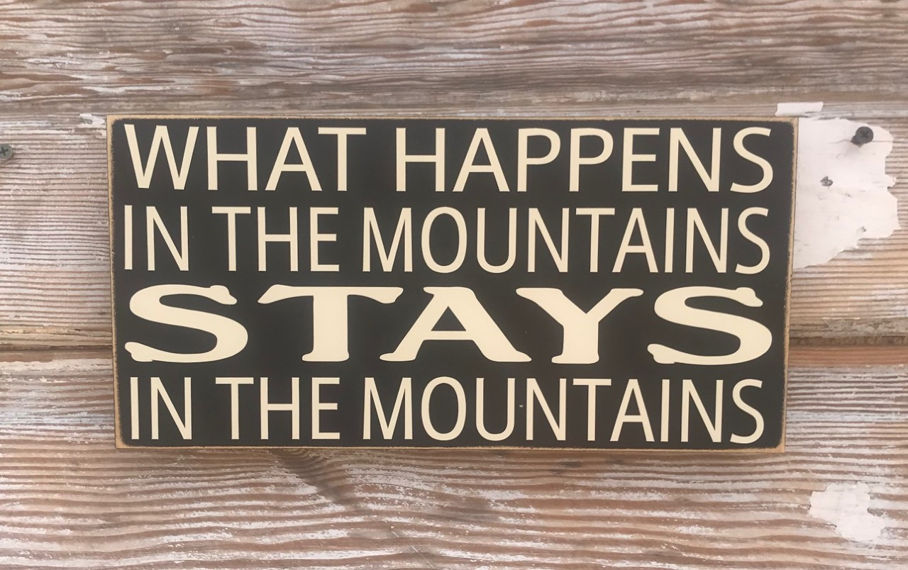 What Happens In The Mountains Stays In The Mountains.  Wood Sign