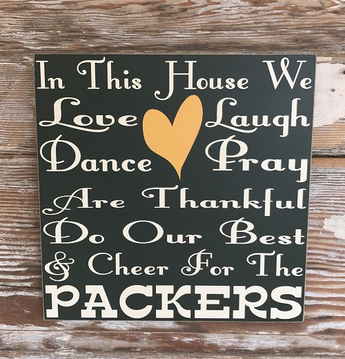 In This House We Love, Laugh, Dance, Pray, Are Thankful, Do Our Best & Cheer For The Packers.    Wood Sign